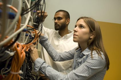 Electrical and Computer Engineering students building a small-scale supercomputer test-bed in the Computer Architecture and Systems Laboratory at the University of Maine.
